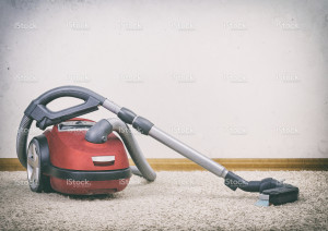 stock-photo-40568300-red-vacuum-cleaner-in-empty-room-photo-with-vignette-